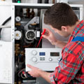 New Jersey Heating Service, Technician servicing heating boiler