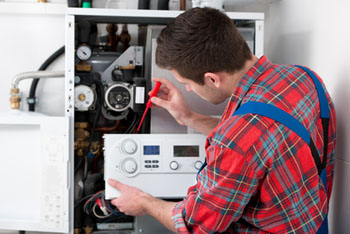 New Jersey Heating Repairs, Technician servicing heating boiler