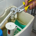 New Jersey Plumber, Close up of hand repairing toilet with pliers