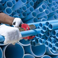 New Jersey Plumber, Worker cut pvc pipe in construction site